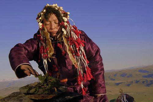 A Tuvan shaman burning cedar on a mountain top in western Mongolia.