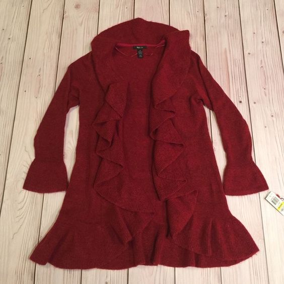 Price Decrease Style and Co Gorgeous Red Duster This a such a beautiful red duster /cardigan! It has a nice ribbed sweater knit material. Cute bell sleeves and cascade ruffles along the neckline and back. Perfect for the fall and winter months! Style & Co Sweaters