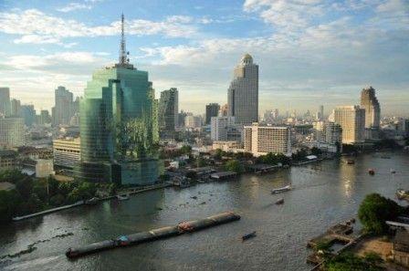 Bangkok river scene © Emilio Labrador - Bangkok's skyline reflects the rapid growth of the city over the last century.