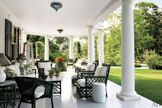 Love this elegant white porch with black shutters, rattan and wicker furniture and black...very chic way to relax outside.  http://cococozy.com
