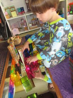 playing with magna tiles, crystal cubes, and more on a mirror!