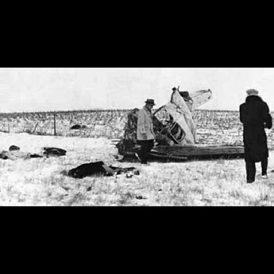 """February 3, 1959. Ritchie Valens lies in the foreground, Buddy Holly is next and J.P. """"Big Bopper"""" Richardson's body was thrown over the fence."""