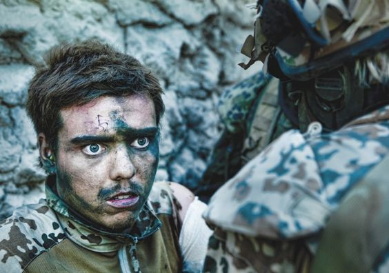 Wounded Danish soldier moments after close combat (Afghanistan 2010)