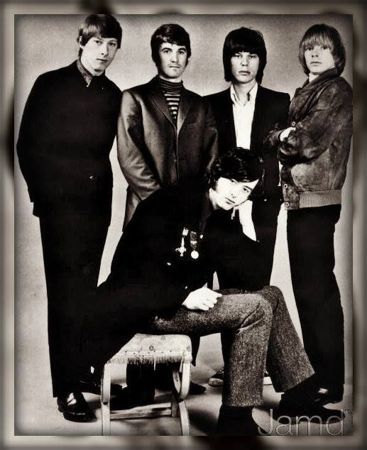 Yardbirds with Jimmy Page sitting down and Jeff Beck second from right.