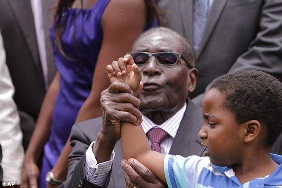Zimbabwean President Robert Mugabe  attempts to make Dali Thando Phekezela Mphoko, the gra...