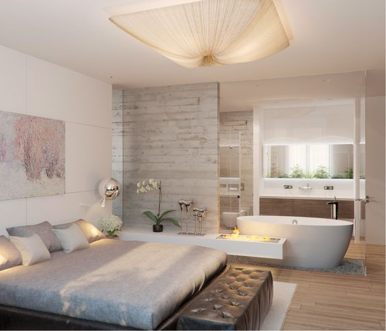 A Modern Rustic Bedroom With A Bathtub Integrated Into The Decor For More Interest And A Spa Fe Master Bedroom Bathroom Bedroom With Bath Open Concept Bathroom