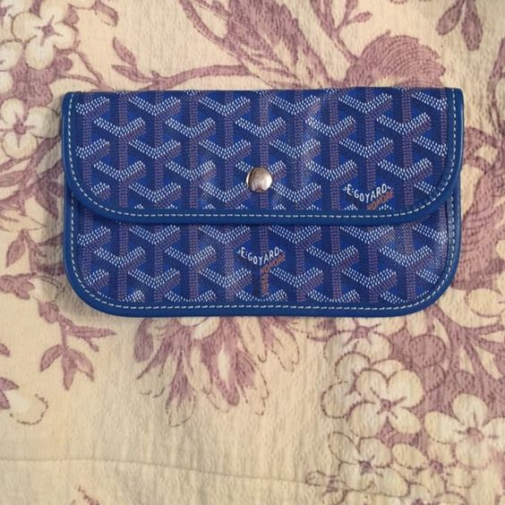 Blue Goyard mini wallet Never been used! Apart of a tote bag I purchased. Perfect for fitting cash or small items. Very rare to find Goyard Bags Wallets