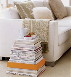 """Books as a side table! I used fake books that open and allow for storage. Each of my """"books"""" are traveled themed and represent places I have been :)"""