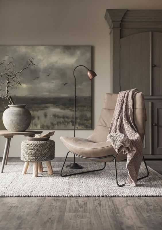 Moody grat and greige chair, artwork and armoire