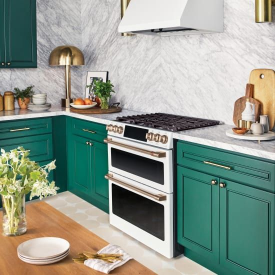 3 Unique Ways To Customize The Kitchen Of Your Dreams Green Kitchen Cabinets Green Kitchen Designs Popular Kitchen Designs Most popular kitchen room decoration