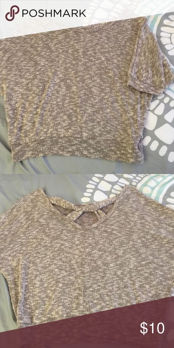 Gently worn x back cropped sweater Tag cut out because it was itchy but other then that no signs of wear Sweaters