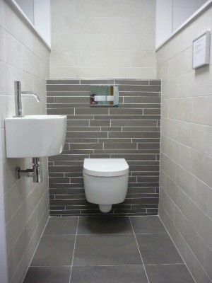 bathroom with grey tiles at welke.nl