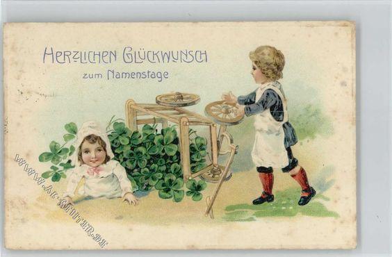 Kinder mit einem Holzwagen voll Glückklee: Ansichtskarten-Center Onlineshop