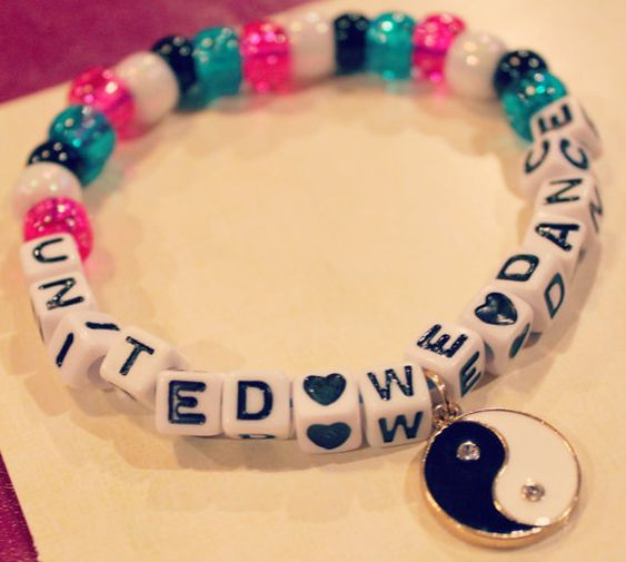 United We Dance Kandi with Ying Yang Charm