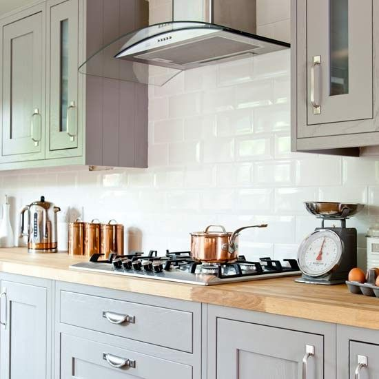 Country kitchen with shaker cabinetry and wooden worktop for Grey country kitchen