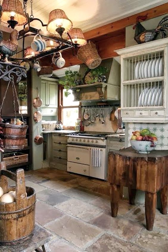 Rustic European country kitchen with plate rack and butcher block table. #european #country #kitchen #rustic