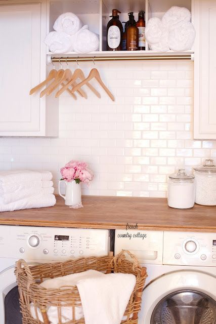 clean minimal chic laundry room