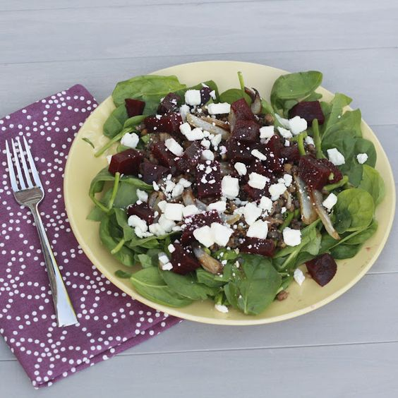 Spinach salad with beetroot, asparagus, caramelised onions, lentils and feta