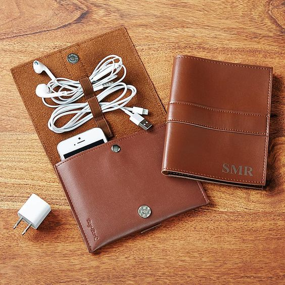 Give high-tech travelers a stylish way to protect their smart phone or cut the clutter of cords and accessories that comes with it.