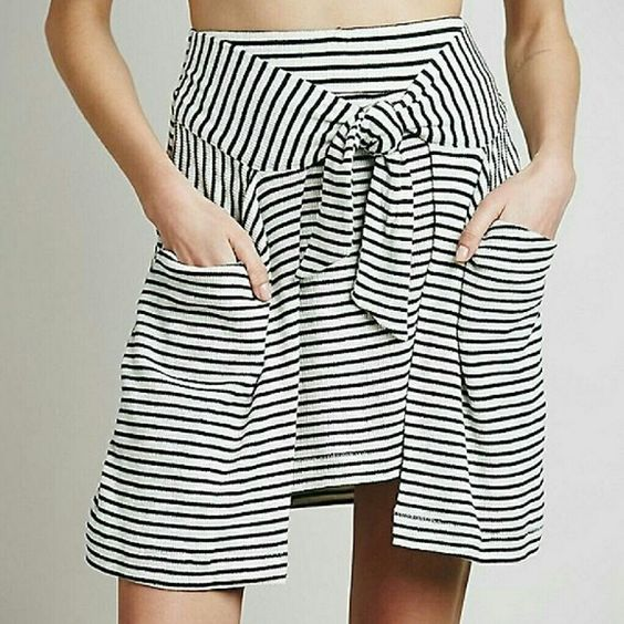 All Tied Up Skirt Striped mid-length skirt in a stretchy and lightweight thermal fabric, with tied sleeve-like detail that drapes below the waistband. Machine washable. In 'Ivory Combo'. Size small but runs slightly large, best fit for 6-8. Free People Skirts