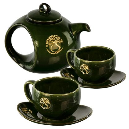 Add a little magic to tea time along with a spiritual flare with this unique ceramic tea set. Each piece of this lovely green ceramic tree of life tea set has been embossed with a golden tree of life. Set includes a portly three-cup-capacity tea pot, two matching round cups and saucers. The set has a beautiful high-gloss finish. 3 Cup Capacity. Hand made in Bali, and fair trade.  ***ACCEPTING PRE-ORDERS NOW. WILL BE IN STOCK IN 3 WEEKS (AUGUST 6th)***
