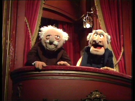 Waldorf and Statler, the Heckling Critics from the stage left balcony box in the Muppet Theatre