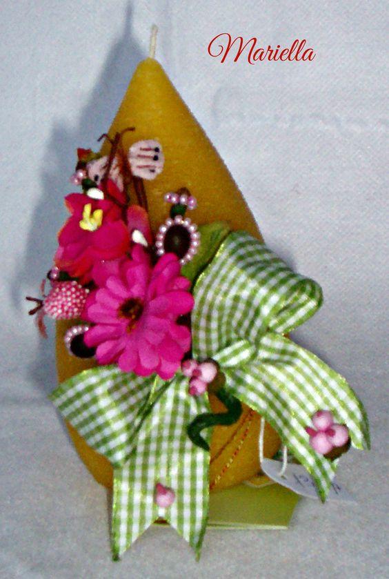 decorazione composta da : caffe', chiodi di garofano decorati con perline rosa, fiori fuxia, farfallina rosa, bacche rosa nastro a quadretti verde