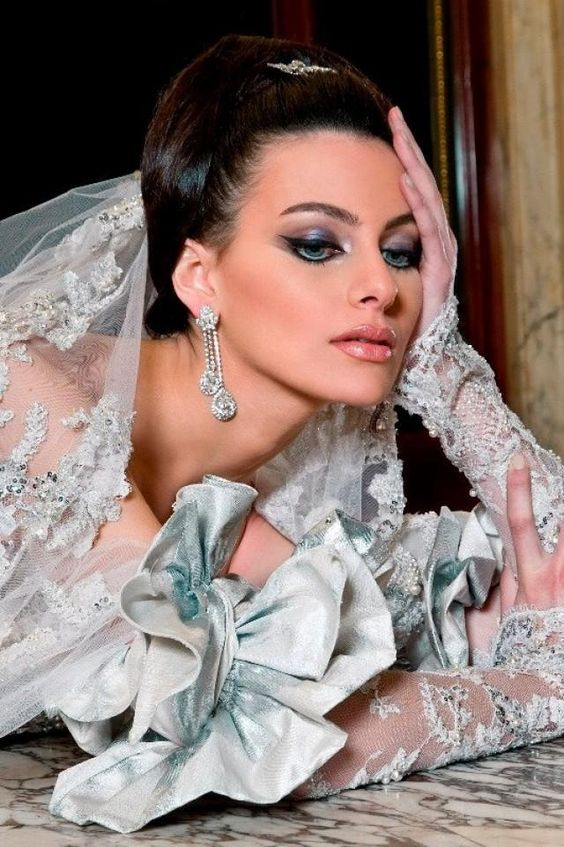 See more about blue wedding gowns, eye makeup and silver.