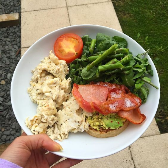 B R E A K F A S T  today's breakfast is some scrambled eggs cooked in some coconut oil with a crumpet topped with smashed avocado crispy bacon grilled tomato asparagus and some spinach and rocket  #blogger #bodybuilding #booty #clean #healthy #health #fitfam #fitness #macros #muscles #motivation #health #healthy #protein #clean #cardio #weights #shred #bulk #gains #girlgains #girlswholift #girlsthatlift #workout #bbg #bikini #lean #iifym #nutrition