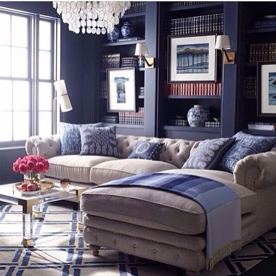The @JonathanAdler Jacques Lucite Coffee Table enhances this tailored interior with a glamorous  brass accent. Photo via @idapryser #CocoRepublic #JonathanAdler #interiordesign #homestyle