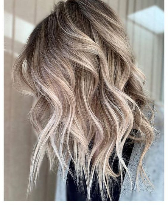 Ash blonde hair tone with dark roots