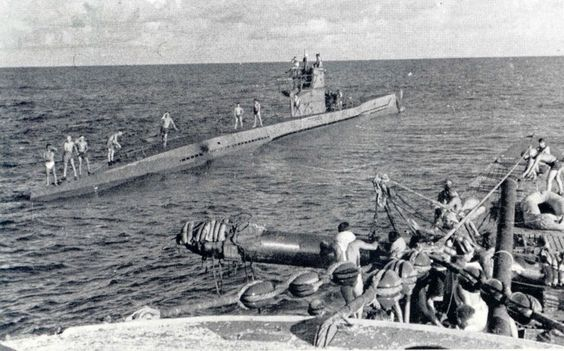 A U Boat is resupplied with torpedoes from another U Boat whilst in the Caribbean in early August 1942.