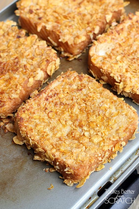 Crunchy French Toast -- traditional French toast, coated in crushed cornflakes, and served with syrup and fruit