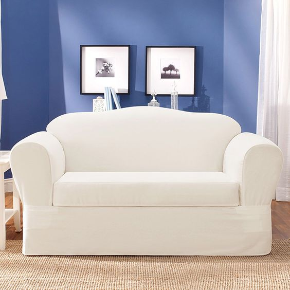 Breathe new life into any sofa in your home with this high-quality white stretch sofa slipcover. This cotton slipcover features an elastic construction that will give your sofa a clean, custom look and is durable to hold up against heavy wear.