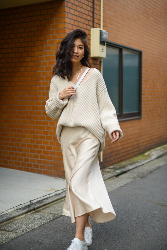 Chunky knit sweaters for fall, beige satin skirt and oversized sweater, satin skirt outfit ideas, long satin skirt outfit ideas for fall, winter white outfits, monochromatic white outfits, Meli Melo Santina bucket bag, white bucket bag outfit ideas, street style, FOREVERVANNY style - Acne Studios Ribbed Wool Sweater Two Ways / FOREVERVANNY