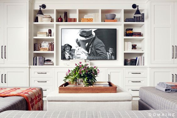 White built-in shelves with television