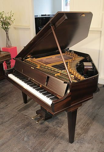 A 1932,  Neo-Bechstein electric grand piano with a mahogany case. The first electric grand piano and home entertainment system, incorporating a radio, record player and amplifier. This instrument allowed the pianist to play alone or accompany the built-in tube radio  or the record player. The Neo-Bechstein incorporates many pioneering inventions and features the first electromagnetic pick-up. This Neo-Bechstein  is 83 years old and is one of three globally that is still in working condition.