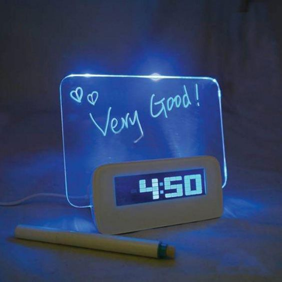 EZ Snooze - Wake up to your alarm, as well as a pleasant message. Whether it's a reminder or note to that special someone, this fluorescent board will help remind you and others of important messages. With a digital built-in alarm clock and calendar, your mornings will be made much more simpler.