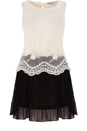 This two tone dress has a lace textured section to the top half with a pleated skirt to the bottom and is sleeveless in style.