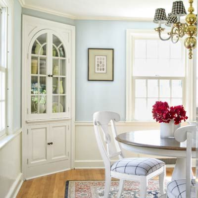 "Talk about a space-smart upgrade! Way to put a corner to work! ""The original three-corner cupboard was revived with semigloss paint, and the original oak floors were refinished with polyurethane."""