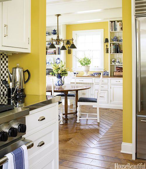 Charming retro style yellow kitchen takes great advantage of some weird space. By Mick DeGuilio on the North Shore of Chicago.
