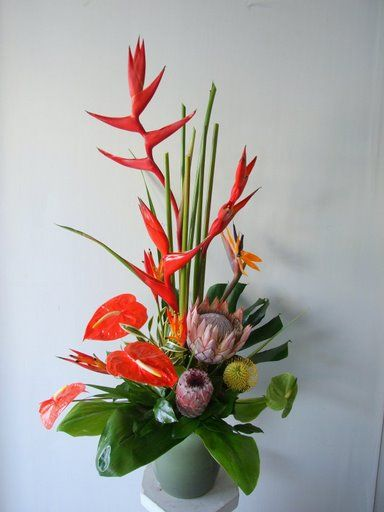 Tropical flower arrangment reception wedding flowers