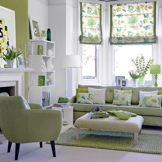 This white and green living room is alive with style. very inviting, great patterns and accents, modern furniture. Really like this space.: