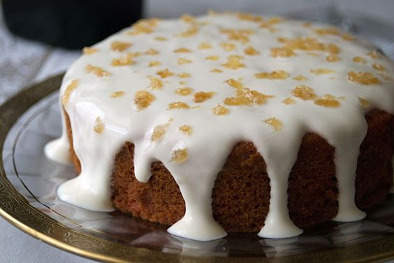 Sweet, moist whole wheat cake made with roasted beets and soaked in orange juice and topped with sweetened sour cream and crystallized ginger