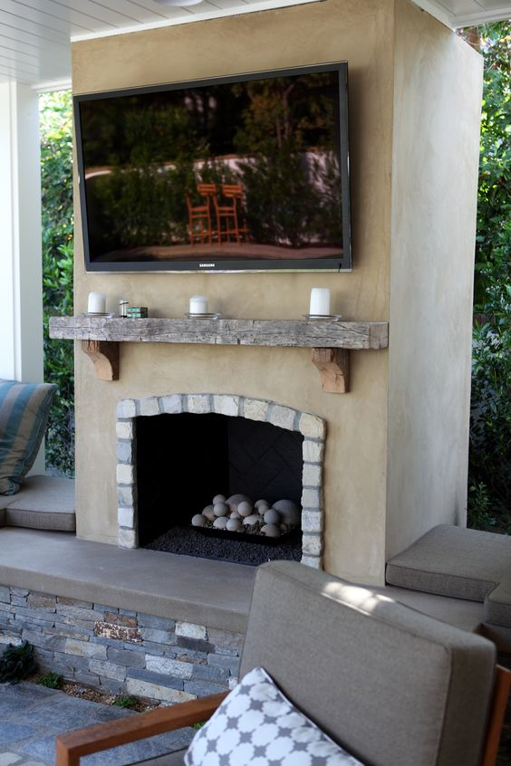 Smooth Stucco Fireplace With Lompoc Cobblestone And A Reclaimed Wood Mantle