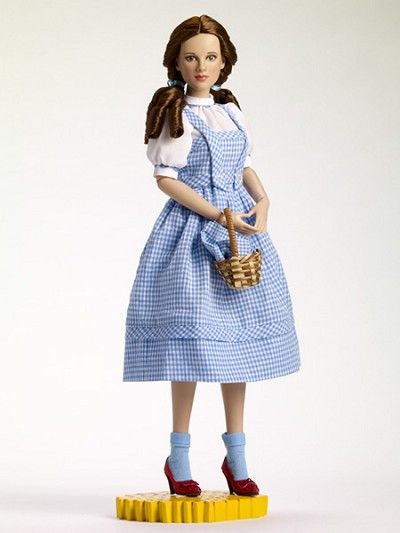 """TONNER 2012  Wizard of Oz  DOROTHY GALE  Dressed Doll - LE500  Face includes hand-painted details  Fine quality vinyl and hard plastic  Judy Garland as Dorothy head sculpt #3  16"""" teen age body  Dark brown hand-painted eyes  Rich brown rooted saran hair  Tyler skin tone  White cotton blouse with blue ric-rac trim  Blue and white cotton gingham jumper  White cotton jersey panties  Blue cotton jersey socks  Blue hair ribbons  Ruby red slippers  Your Price: $149.99"""