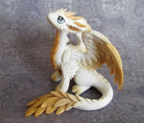 It is an angel dragon! | A gold and white Polymer Clay dragon with featheres wings