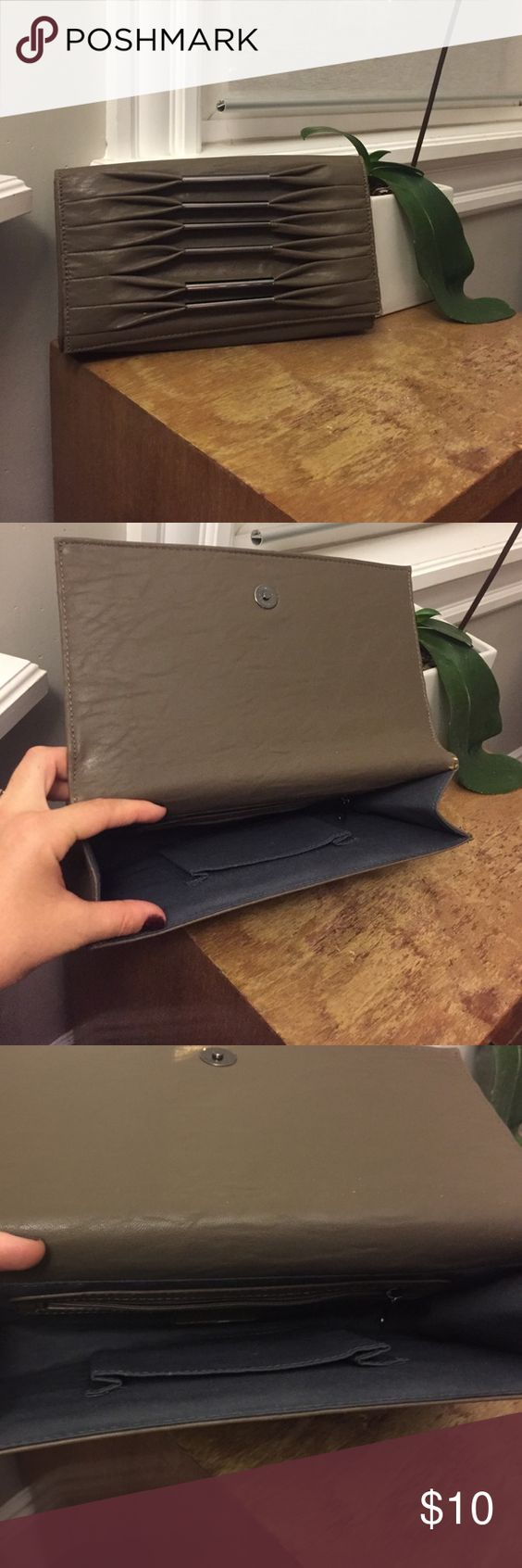 Large grey clutch Large grey clutch. Not real leather. Originally from DSW. Very minor wear on one corner. Great for going out! Bags Clutches & Wristlets