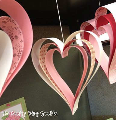 Paper Strip Hearts. Connect them in a chain or garland, add string and hang them somewhere, paste one on the front of a homemade Valentine, etc.  Looks like a good Valentine Craft!