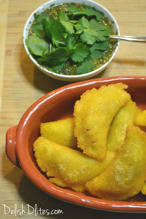 Colombian empanadas feature a crunchy cornmeal dough, filled with a creamy, aromatic beef and potato filling, spiced with cumin and Sazon.  These empanadas are a perfect appetizer for any party!